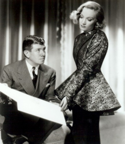 Travis Banton and Marlene Dietrich reviewing a  costume sketch
