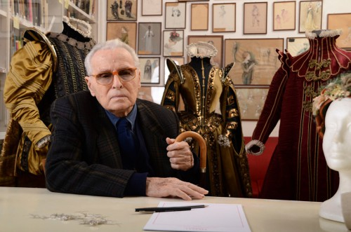 Piero Tosi in front of his costumes and sketches
