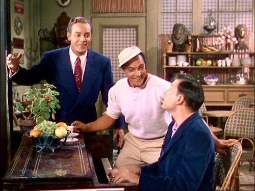 From left to right Georges Guetary, Gene Kelly, and Oscar Levant